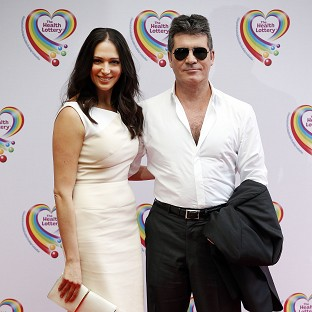 Simon Cowell and Lauren Silverman have reportedly bought a home in Manhattan