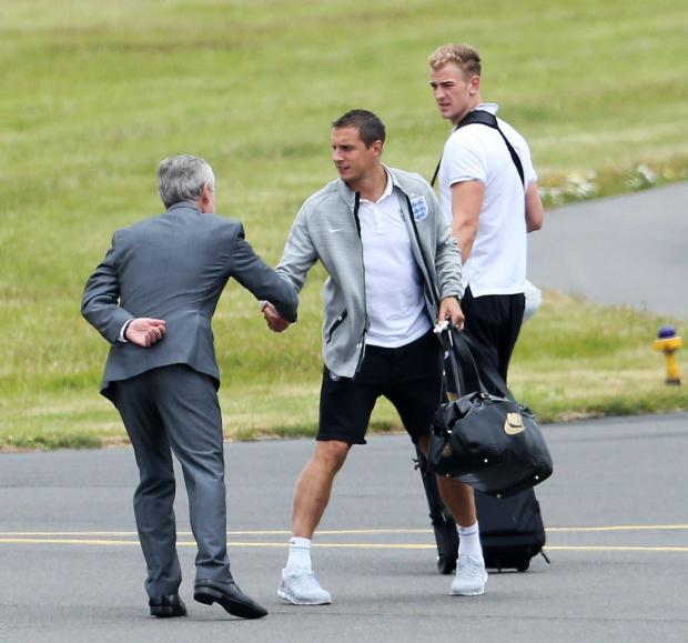Phil Jagielka and Joe Hart at Manchester Airport this afternoon