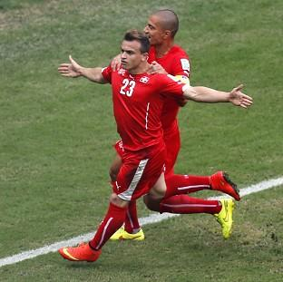 Switzerland's Xherdan Shaqiri celebrates opening the scoring (AP)