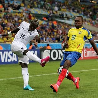 Ecuador's Walter Ayovi, right, and France's Bacary Sagna battle for the ball in their goalless draw