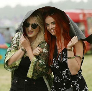 Wellies deployed for festival rain