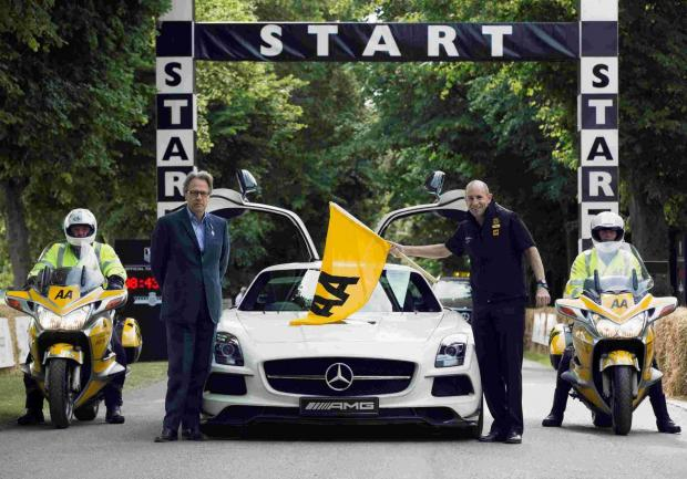 Hampshire Chronicle: AA chief executive Chris Jansen flags off The AA as a PLC with Lord March at Goodwood on Thursday