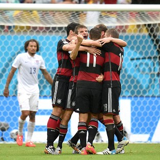 Germany's Thomas Muller, centre, celebrates scoring the winner