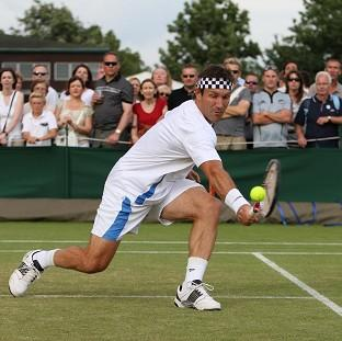 Pat Cash in action at Wimbledon in 2010 wearing his trademark headband