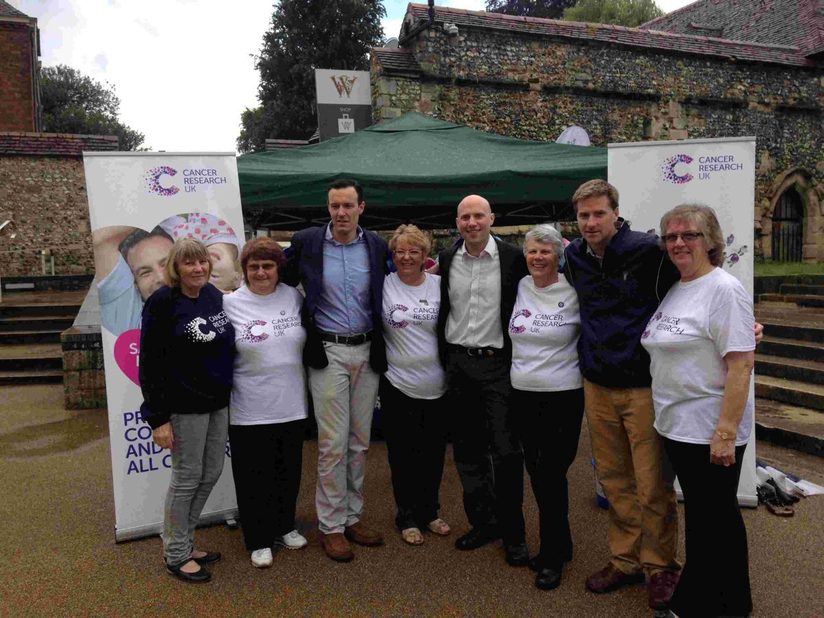 Members of the local Cancer Research UK committee, with Tim Underwood (left), Carl Edwards, a sponsor, (centre) and Steve Brine MP (right).