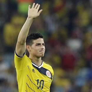James Rodriguez's brace sent Colombia into the last eight (AP)