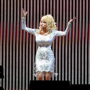 Hampshire Chronicle: Dolly Parton was given an award backstage at Glastonbury Festival