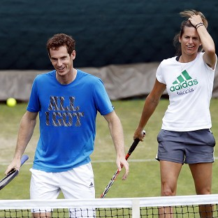 Andy Murray, left, training at Wimbledon's Aorangi Park with coach Amelie Mauresmo