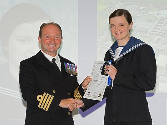 Claire Martin receives her certificate of course completion from Captain Chris Hodkinson
