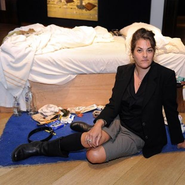 Hampshire Chronicle: Tracey Emin with her work My Bed