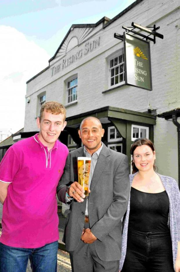 Hampshire Chronicle: L-R: Marcus Baldwin, publican Chris Wood and Ferne Phillips