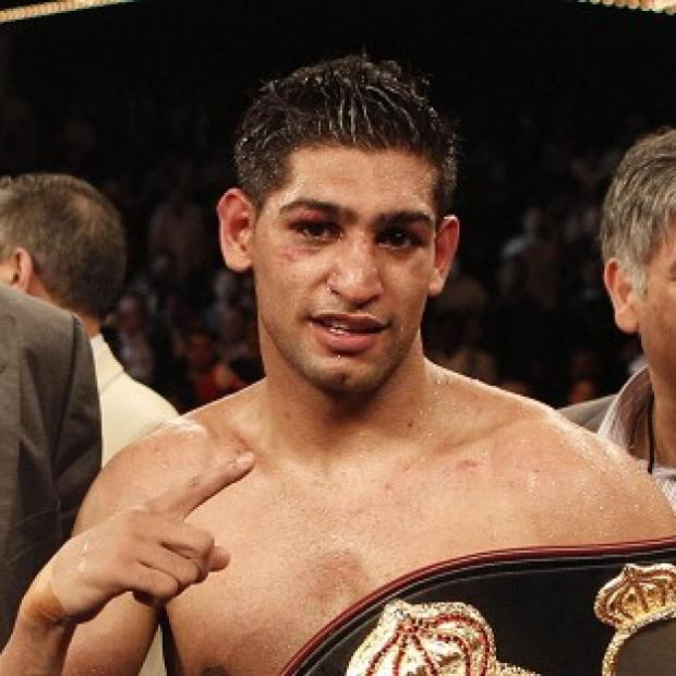 Hampshire Chronicle: Boxer Amir Khan was arrested over an alleged assault in Bolton