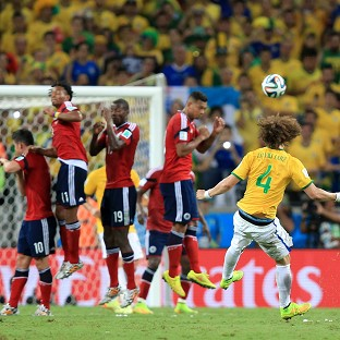 David Luiz scored Brazil's second goal as the hosts beat Colombia