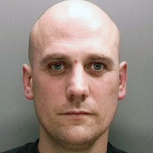 Violent robber jailed for life