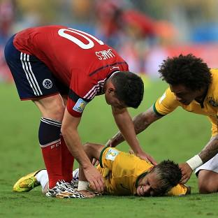 James Rodriguez, left, and Marcelo show concern for Neymar after the injury which ended his World Cup