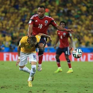 Neymar, front, suffered a fractured vertebra in this challenge from Juan Zuniga, ending his World Cup