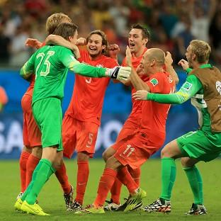 Tim Krul, front left, leads the celebrations after guiding Holland into the World Cup semi-finals