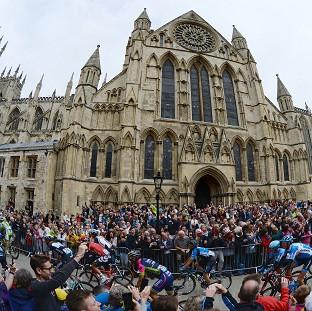 Hampshire Chronicle: The Peloton passes York Minster during the 2014 Tour de France.