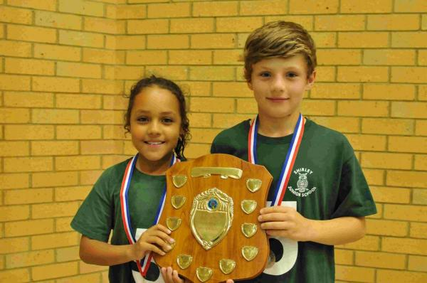 Jasmine Brooks and Oliver Cazaly collecting the primary school team trophy on behalf of Shirley Junior School