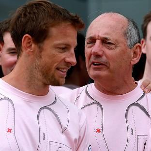 Jenson Button, pictured here with Ron Dennis, finished fourth at Silverstone