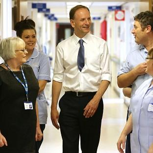 Hampshire Chronicle: Simon Stevens (centre) says five million people could be using the new system by 2018