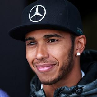 Lewis Hamilton is all smiles again after his recent British Grand Prix victory