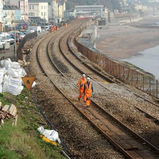 Hampshire Chronicle: Engineers from Network Rail carry out repair work to the Great Western Main Line in Dawlish, which was damaged during winter storms last month