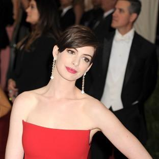 Hampshire Chronicle: Anne Hathaway dresses as a dude for a new music video
