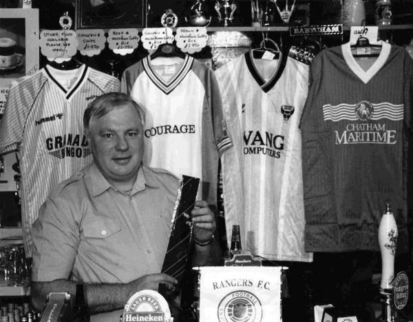Mike King, pictured in July 1989, with a number of football shirts that were lots in a charity auction organised by him in aid of the Hillsborough disaster