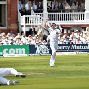 James Anderson celebrates taking the wicket of India opener Shikhar Dhawan