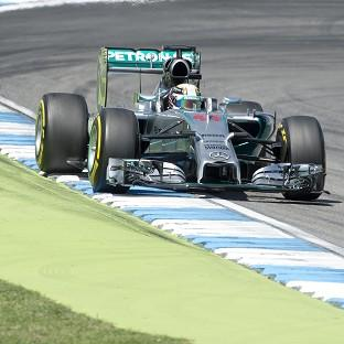 Lewis Hamilton, pictured, edged out team-mate Nico Rosberg in second practice (AP)