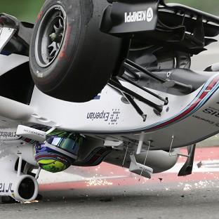 Felipe Massa was flipped over at the first corner on Sunday (AP)