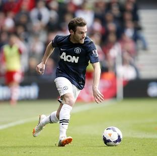 Juan Mata is confident that Manchester United can win trophies under Louis van Gaal