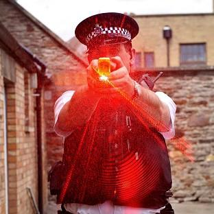Tasers should not be used as a means of 'pain compliance', a report has said