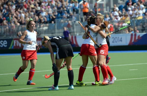 Alex Danson, right, celebrates her goal against Wales today.