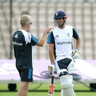 Alastair Cook, right, is under