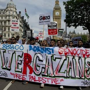 Protesters against military action in Gaza march through Westminster, central London.