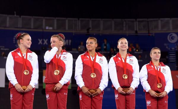 Kelly Simm, second from right, with her teammates