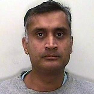 Family GP Dr Davinder Jeet Bains used a secret camera inside his James Bond-style wristwatch to r