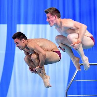 James Denny, right, and Tom Daley, left, executed a stunning last dive to take silver