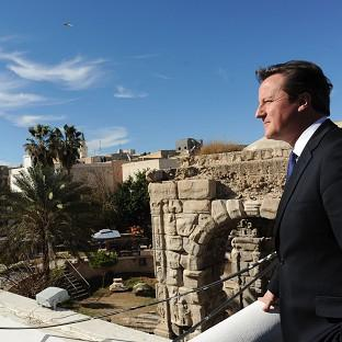 Prime Minister David Cameron looks out over Tripoli on a visit last year