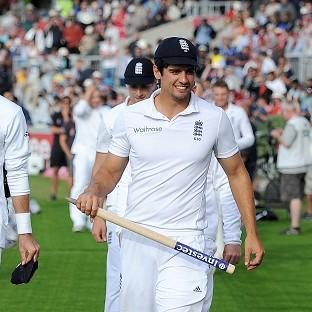 Captain Alastair Cook celebrates England's emphatic win over India