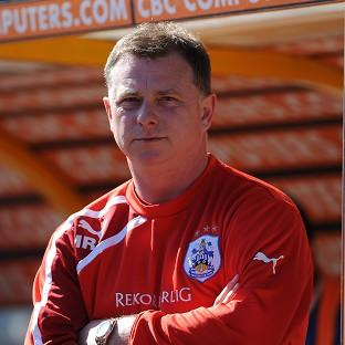 Mark Robins has left his role as Huddersfield manager