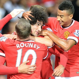 Marouane Fellaini, centre, celebrates after scoring the winner in stoppage time