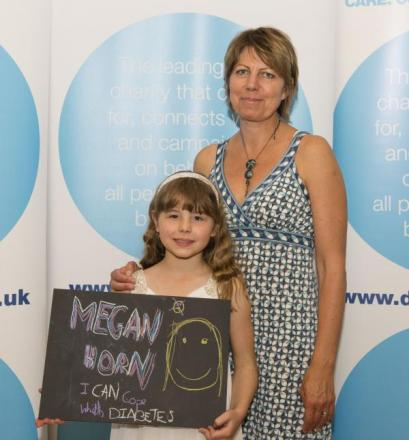 Megan Horn, aged eight, met George Hollingbery MP to discuss school care for children with diabetes