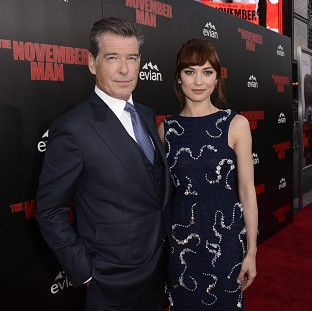 Pierce Brosnan and Olga Kurylenko at the Los Angeles premiere of The November Man