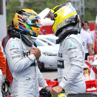Lewis Hamilton, left, and Nico Rosberg, right, have dominated their opponents this season