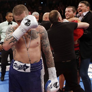 Ricky Burns, left, was stunned by Dejan Zlaticanin