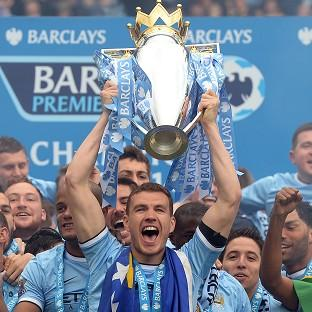 Edin Dzeko has won two league titles with Manchester City