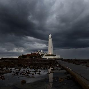 Storm clouds gathering over St. Mary's lighthouse in Whitley Bay, with more rain forecast for Bank Holiday Monday